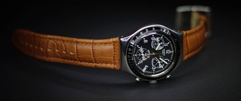 Wristwatch with black dial and brown leather straps