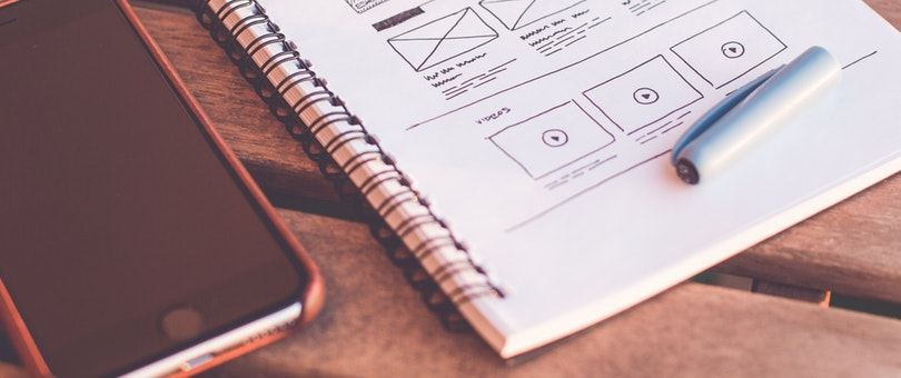 notebook with drawing of ux and interaction elements